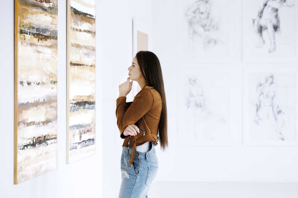 a woman in an art gallery