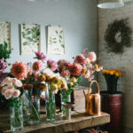 bunches of beautiful flowers in vases on a countertop | Austin florists