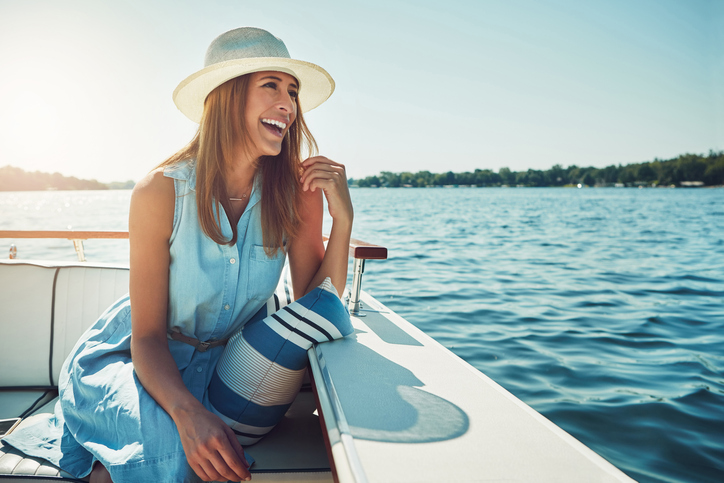 a person looks over a boat edge | boat tour in Austin